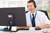 Technical support operator working on computer — Stock Photo