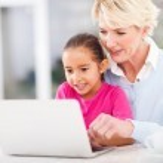 Modern grandmother teaching grandchild computer — Stock Photo #32774051