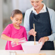 Grandmother and granddaughter baking cookies — Stock Photo #32774477