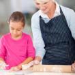 Grandmother and granddaughter making cookies — Stock Photo