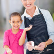 Little girl and senior grandmother baking — Stock Photo #32774747