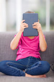 Little girl behind a tablet pc — Stock Photo
