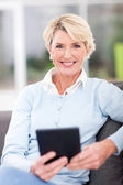 Modern senior woman with tablet computer — Stock Photo