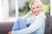 Middle aged woman relaxing at home — Stock Photo