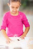 Little girl baking cookies — Stock Photo