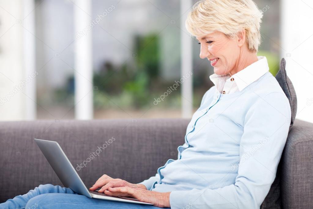 Elderly Using Facebook Happy Elderly Woman Using