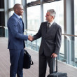 Stock Photo: Business travelers meeting at airport