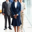 African female business leader with team — Stok fotoğraf