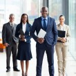 African business leader and team — Stock Photo