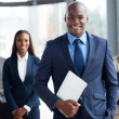 African businessman with group of businesspeople — Stock Photo