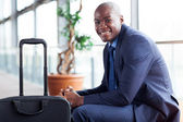 African american businessman waiting in airport — Stock Photo