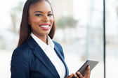 Black businesswoman with tablet computer — Stock Photo