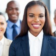 Young african businesswoman with colleagues — Stock Photo