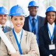 Young female architect and colleagues — Stock Photo