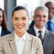 Businesswoman with co-workers — Stock Photo
