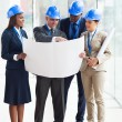 Stock Photo: Group of architects working on project