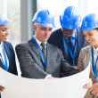 Stock Photo: Group of architects discussing project