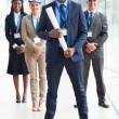 African american architect standing in front of colleagues — Stock Photo #34113879