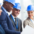 Senior construction manager working with team — Stock Photo