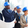 Construction team discussing architectural project — Stock Photo