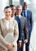 Group of business executives standing in a row — Stock Photo