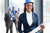 African american architect holding blue print — Stock Photo