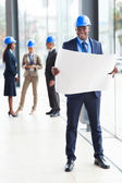 Afro american architect standing in office — Stock Photo