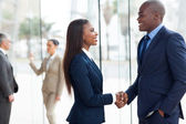 African business people handshaking — Stok fotoğraf