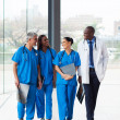Group of medical doctors walking in hospital — Stock Photo