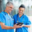 Healthcare workers using tablet computer — Stock Photo #34179461