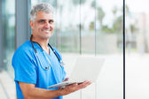 Senior male nurse using laptop — Stock Photo