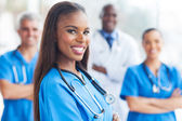 African female nurse with colleagues — Stock Photo
