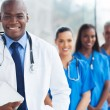 Young african american doctor and colleagues — Stock Photo