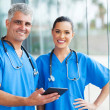 Medical doctors using tablet pc — Stock Photo