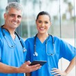 Stock Photo: Medical doctors using tablet pc