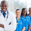 African medical doctor and colleagues in hospital — Stock Photo