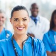 Medical nurse and colleagues — Stock Photo