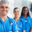 Senior medical doctor and team — Stock Photo