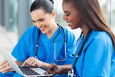 Healthcare workers using laptop — Stock Photo