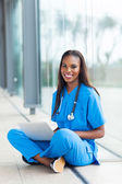 Black healthcare worker using laptop — Stock Photo