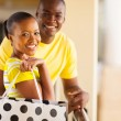 Young african couple with shopping bag — Stock Photo