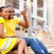 African american couple sitting outdoors in the city — Stock Photo