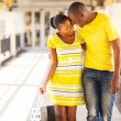 Afro american couple in shopping mall — Stock Photo