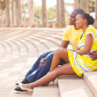 African american couple sitting in park — Stock Photo