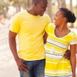 Black young couple walking in the street — Stock Photo