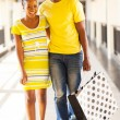 Young african couple in shopping center — Stock Photo #34425397