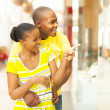 African couple shopping in mall — Stock Photo