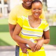 Lovely afro american couple with shopping bag — Stock Photo
