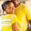 Loving african couple hugging — Stock Photo