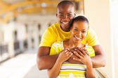 Young african american couple hugging — Stock Photo